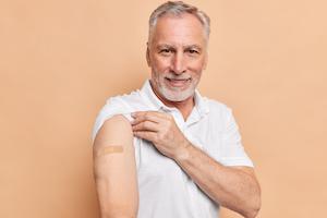 Senior man getting flu shot